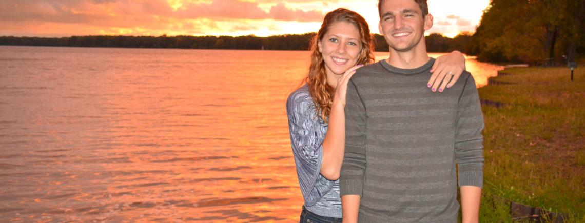 newly engaged couple at sunset