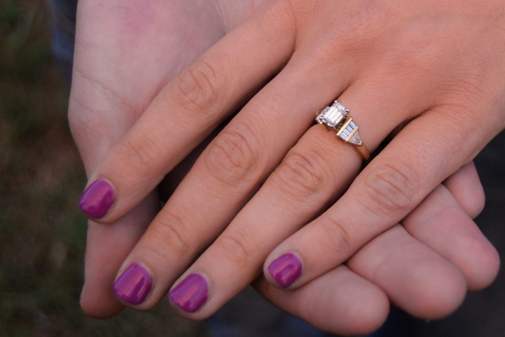 woman with diamond engagement ring